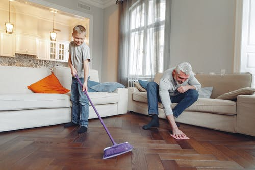 A family cleaning their house together.