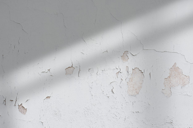 chipping paint on a kitchen wall because of water damage